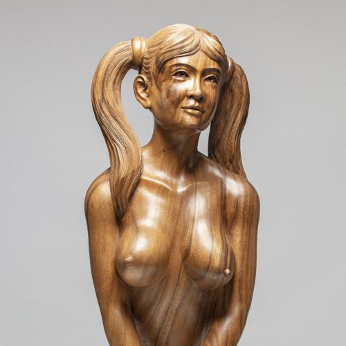 Erotische Holzskulptur